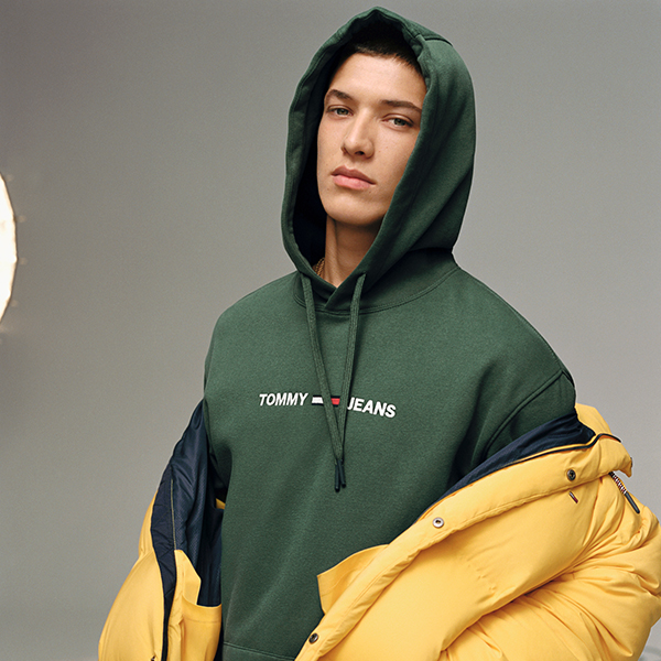 Man Wearing A Hoodie and a yellow puffer jacket
